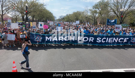 """Washington, DC, USA. 14th April, 2018.  Participants in 2018 March for Science after listening to speakers at rally, begin the march to the U.S. Capitol.  Among demands, a call """"for public officials to enact evidence-based policy that serves all communities.""""  Bob Korn/Alamy Live News - Stock Photo"""
