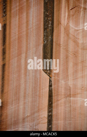 Desert varnish on Navajo sandstone near Lower Calf Creek Falls in the Grand Staircase/Escalante National Monument, Utah - Stock Photo