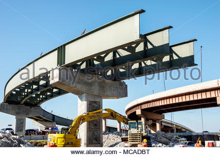 Florida Miami LeJeune Road roadway construction highway expressway flyover bridge overpass curve steel beams unfinished - Stock Photo