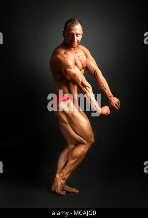 Male Bodybuilder Flexing Muscles Side View Stock Photo 86259567