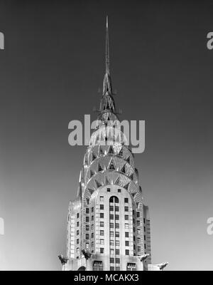 The Chrysler Building is an Art Deco style skyscraper in New York City, located on the east side of Manhattan in the Turtle Bay area at the intersection of 42nd Street and Lexington Avenue. At 1,046 feet , the structure was the world's tallest building for 11 months before it was surpassed by the Empire State Building in 1931 It is still the tallest brick building in the world, albeit with an internal steel skeleton. - Stock Photo