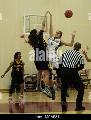 Izabel Tayag, center for the Kadena Panthers, left, and Bua Rojanasoonthoon, a center with the American School of Bangkok Eagles, tip-off the ball during the International Far East Basketball tournament championship at Marine Corps Air Station Iwakuni, Japan, Feb. 1, 2018. Six division-one teams challenged each other to compete for the girl's International Far East championship title. As time dwindled down it approached overtime, but a few steals, a lay-up and a couple of rebounds later the Eagles came out on top with a winning score of 47 to 42. (U.S. Marine Corps photo by Lance Cpl. Mason Ro - Stock Photo