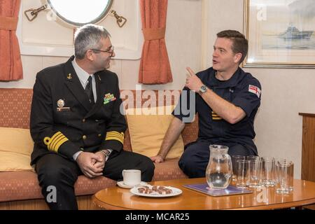 CONSTANTA, Romania, Feb 1. 2018 SNMCMG2 Commander, Justin Hains speaks with leadership from the Romanian Navy Hydrographic and Mine Warfare officers for an official visit aboard HMS Enterprise while the group is import Constanta, Romania February 1-4. - Stock Photo