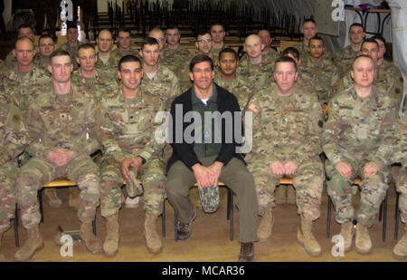 Yavoriv, Ukraine – Mark T. Esper, the United States Secretary of the Army poses for a photo with New York Army National Guard Soldiers assigned to Joint Multinational Training Group – Ukraine here Feb. 2. Currently more than 220 Soldiers from New York's 27th Infantry Brigade Combat Team are deployed to Ukraine where they are working hand-in-hand with the Ukrainian Army as they work toward obtaining its goal of NATO interoperability. (U.S. Army photo by Sgt. Alexander Rector) - Stock Photo