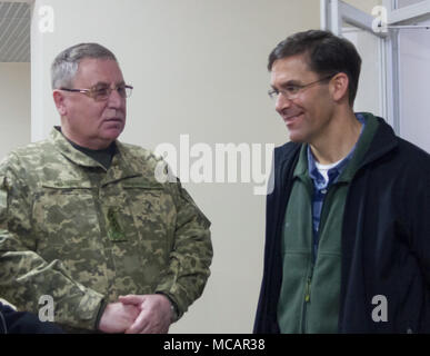 Yavoriv, Ukraine – Mark T. Esper, the United States Secretary of the Army meets with Ukrainian Lt. Gen. Pavlo Tkachuk  during a visit to the Yavoriv Combat Training Center here Feb. 2. Currently more than 220 Soldiers from New York's 27th Infantry Brigade Combat Team are deployed to Ukraine where they are working hand-in-hand with the Ukrainian Army as they strive toward obtaining its goal of NATO interoperability. (U.S. Army photo by Sgt. Alexander Rector) - Stock Photo