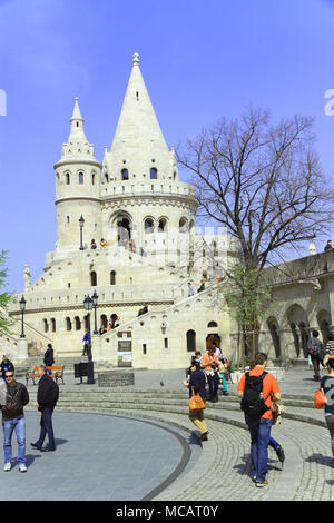 View of tourists and holiday makers around the Fisherman's bastion in  Hungarian capital city of Budapest Hungary  enjoying spring sunshine - Stock Photo
