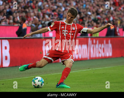 Munich, Germany. 14th Apr, 2018. Bayern Munich's Thomas Mueller competes during a German Bundesliga match between Bayern Munich and Borussia Moenchengladbach, in Munich, Germany, on April 14, 2018. Bayern Munich won 5-1. Credit: Philippe Ruiz/Xinhua/Alamy Live News - Stock Photo