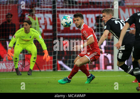 Munich, Germany. 14th Apr, 2018. Bayern Munich's Juan Bernat (C) controls the ball during a German Bundesliga match between Bayern Munich and Borussia Moenchengladbach, in Munich, Germany, on April 14, 2018. Bayern Munich won 5-1. Credit: Philippe Ruiz/Xinhua/Alamy Live News - Stock Photo