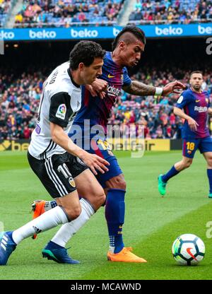 Barcelona, Spain. 14th Apr, 2018. Barcelona's Paulinho (R) vies with Valencia's Dani Parejo during a Spanish league soccer match between Barcelona and Valencia in Barcelona, Spain, on April 14, 2018. Barcelona won 2-1. Credit: Joan Gosa/Xinhua/Alamy Live News - Stock Photo