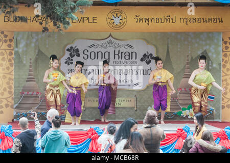 London UK. 15th April 2018. A Traditonal Thai dancers performs  at the Thai New Year (Songkran) at the Buddhapadipa Temple in Wimbledon, the largest Thai temple in the UK with religious ceremonies Thai classical music and dancing performances as well as stalls selling Thai food, groceries and souvenirs Credit: amer ghazzal/Alamy Live News - Stock Photo