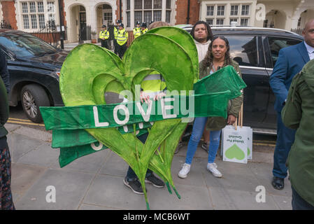 London, UK. 14th Apr, 2018. The lage Grenfell hearts arrive to be carried on the silent walk marking 10 months since the disaster.They want justice with those responsible being brought to trial, for the community concerns to be heard and for changes to be made to ensure safety for all, particularly those living in social housing. Credit: Peter Marshall/Alamy Live News - Stock Photo