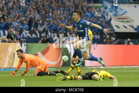 Gelsenkirchen, Germany. 15th Apr, 2018. 15 April 2018, Germany, Gelsenkirchen: Soccer, German Bundesliga, FC Schalke 04 vs Borussia Dortmund at the Veltins Arena: Schalke's Yevhen Konoplyanka (C) celebrates scoring their side's Credit: Ina Fassbender/dpa - IMPORTANT NOTICE: Due to the German Football League·s (DFL) accreditation regulations, publication and redistribution online and in online media is limited during the match to fifteen images per match/dpa/Alamy Live News - Stock Photo