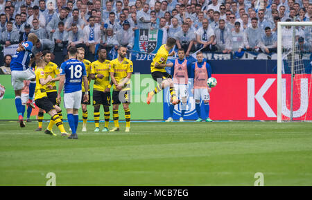 Gelsenkirchen, Germany. 15th Apr, 2018. 15 April 2018, Germany, Gelsenkirchen: Soccer, German Bundesliga, FC Schalke 04 vs Borussia Dortmund at the Veltins Arena: Schalke's Naldo (l) shoots past the Dortmund wall to score for 2:0 Credit: Guido Kirchner/dpa - IMPORTANT NOTICE: Due to the German Football League·s (DFL) accreditation regulations, publication and redistribution online and in online media is limited during the match to fifteen images per match/dpa/Alamy Live News - Stock Photo