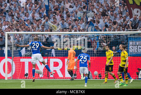 Gelsenkirchen, Germany. 15th Apr, 2018. 15 April 2018, Germany, Gelsenkirchen: Soccer, German Bundesliga, FC Schalke 04 vs Borussia Dortmund at the Veltins Arena: Schalke's Naldo (l) celerbates his goal for 2:0 Credit: Guido Kirchner/dpa - IMPORTANT NOTICE: Due to the German Football League·s (DFL) accreditation regulations, publication and redistribution online and in online media is limited during the match to fifteen images per match/dpa/Alamy Live News - Stock Photo
