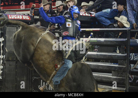 Tacoma, Washington, USA. 14th Apr, 2018. Professional bull rider RYAN DIRTEATER rides the bull CHOPPER during the PBR-Tacoma Invitational at the Tacoma Dome in Tacoma, WA. Credit: Jeff Halstead/ZUMA Wire/Alamy Live News - Stock Photo