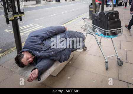 London, UK. 15th April, 2018. A rough sleeper during the day on Oxford Street. Credit: Guy Corbishley/Alamy Live News - Stock Photo