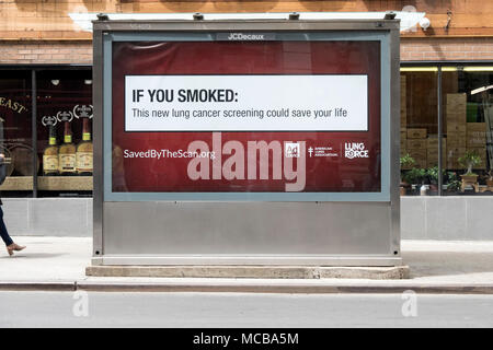 A public health warning sign to smokers & former smokers on the back of a newspaper kiosk on Broadway in Greenwich Village, Manhattan, New York City. - Stock Photo
