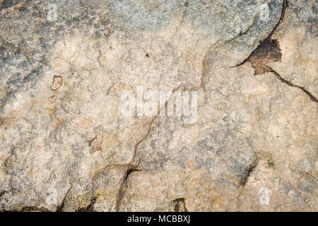 Stone texture. Surface of gritstone on Kinder Scout, Derbyshire, Peak District, England, UK - Stock Photo