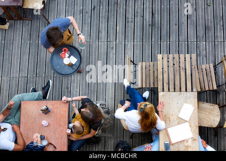 Paris, June 5, 2017 : people is havin lunch in a terrace restaurant, relaxing and friendly moment, style of life. - Stock Photo