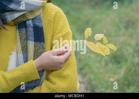 Girl from back in yellow sweater - Stock Photo