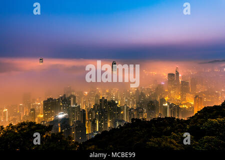 Misty City view from peak at dawn - Victoria Harbor of Hong Kong