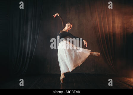 Classical ballet dancer in motion on the stage - Stock Photo