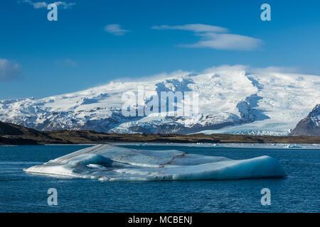 Icebergs Calved into Jökulsárlón Lagoon from Breiðamerkurjökull Glacier coming off  Öræfajökull Volcano along the South Coast of Iceland - Stock Photo