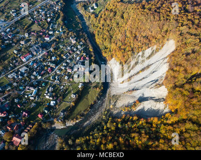 Aerial autumn top view of the Carpathian village at sunny day, Ukraine - Stock Photo