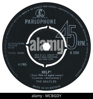 45 RPM 7' UK record label of Help! by The Beatles on Parlophone Records from 1965. Written by John Lennon and Paul McCartney and produced by George Martin. - Stock Photo