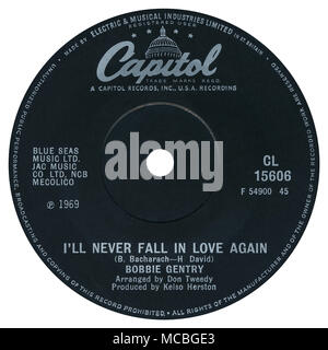 45 RPM 7' UK record label of I'll Never Fall In Love Again by Bobbie Gentry on the Capitol label from 1969. Written by Burt Bacharach and Hal David, arranged by Don Tweedy and produced by Kelso Herston. - Stock Photo