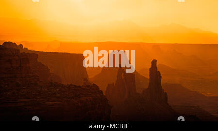 Silhouette, rocks in the morning light, behind the La Sal Mountains, Canyonlands National Park, near Moab, Utah, USA - Stock Photo