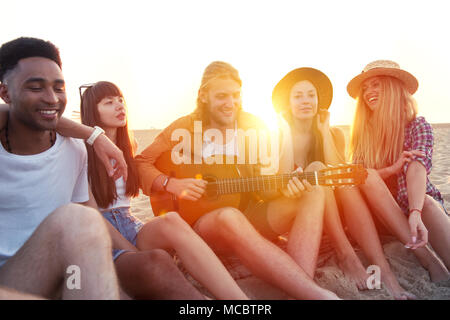 Happy group of friend having party on the beach - Stock Photo