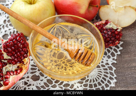 Rosh Hashanah, Jewish New Year holiday concept. Honey, apple and pomegranate on wooden table - Stock Photo