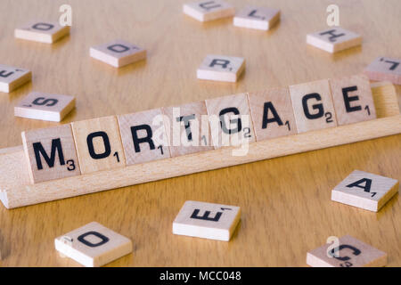 Scrabble letters spelling out the word Mortgage - Stock Photo