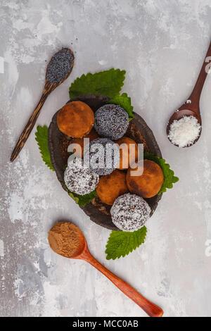 Homemade Healthy vegan Raw Energy Balls with carob, a poppy and coconut. - Stock Photo