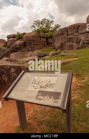 Gettysburg, PA, USA - July 8, 2013:  A visitors marker at Devil's Den on the Gettysburg Battlefield used artillery and infantry on day two of the 1863 - Stock Photo