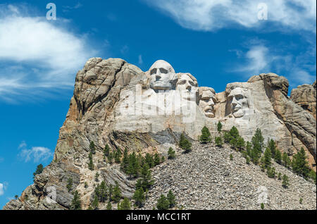 Complete wide angle view of Mount Rushmore national monument with the surrounding forest and nature near Rapid City in South Dakota, USA. - Stock Photo