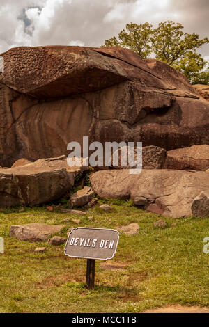 Gettysburg, PA, USA - July 8, 2013:  The Devil's Den sign on the Gettysburg Battlefield near the boulders used by artillery and infantry on day two of - Stock Photo