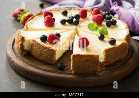 Summer berry cheesecake cut into slices. Selective focus - Stock Photo