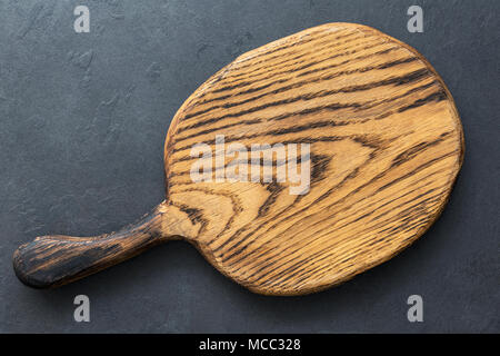 Wooden cutting board on slate background, top view with copy space for text. Horizontal composition - Stock Photo