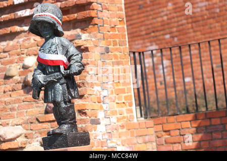 Warsaw Poland statue of The Little Insurgent monument in Warsaw Old Town - Stock Photo