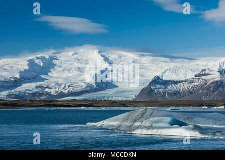 Icebergs Calved into Jökulsárlón Lagoon from Breiðamerkurjökull Glacier coming off  Öræfajökull Volcano along the South Coast of Iceland - Stock Photo