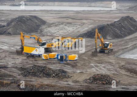North Sea Canal Amsterdam Netherlands - 1 April 2018: Yellow earth moving equipment on landfill site - Stock Photo
