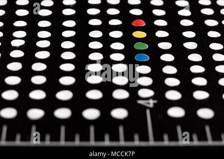 White and colored dots and circles in different patterns at a black or white background - Stock Photo