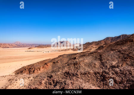 Distant houses in desert on Sinai peninsula - Stock Photo