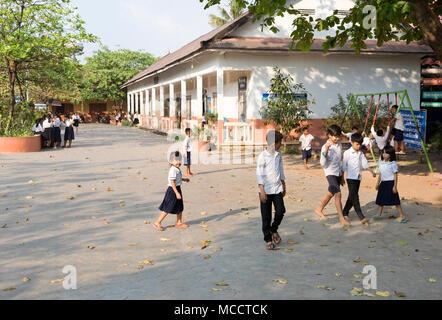 Asia school children - Cambodian primary school children in school playground, Siem Reap, Cambodia, Asia - Stock Photo