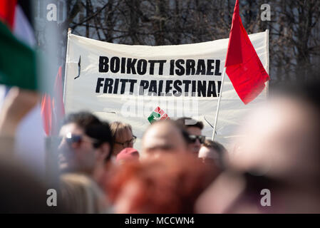 Protesters carry a sign reading 'Boycott Israel, Free Palestine!' as they march to Norway's parliament building to protest Israel's shooting of Palestinians in Gaza. Oslo, April 14, 2018. - Stock Photo