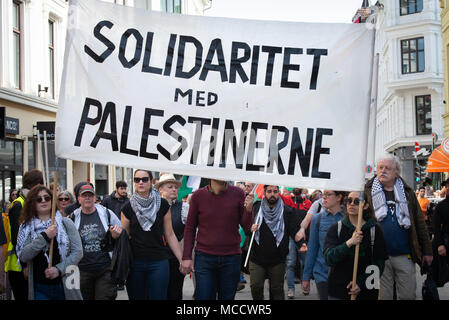 Protesters carry a sign reading 'Solidarity with Palestinians' as they march to Norway's parliament building to protest Israel's shooting of Palestinians in Gaza. Oslo, April 14, 2018. - Stock Photo