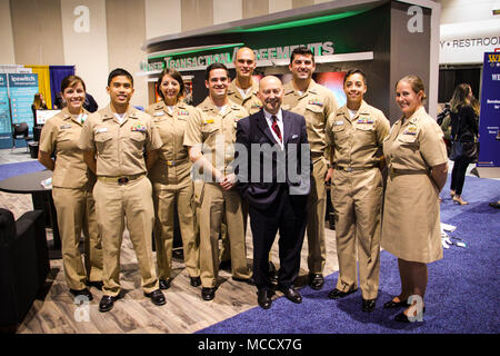 San Diego, Ca. (Feb. 7, 2018) Retired Adm. James Stavridis, center right, poses for a photograph with Surface Warfare Officers and qualified surface Warfare Tactics Instructors (WTI) assigned to Naval Surface and Mine Warfighting Development Center (SMWDC), SMWDC's Sea Combat Division, and Naval Aviation Warfighting Development Center (NAWDC), and USS Zumwalt (DDG 1000) following a WTI panel discussion during WEST 2018, a three-day conference co-sponsored by Armed Forces Communications and Electronics Association (AFCEA) and U.S. Naval Institute (USNI). SMWDC is one of the Navy's five Warfight - Stock Photo