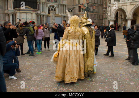 Photographers take pictures of a couple in the carnival costumes in Venice Italy - Stock Photo